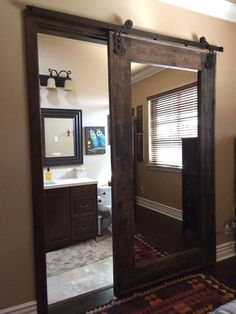 A gorgeous burned pine wood barn door, treated and varnished. Frame is visible on both sides and the screws are visible on the flat side. Iron accents are an option. Option of mirror on one or Wood Barn Door, Diy Barn Door, Barn Door Hardware, Farm Door, Metal Barn, Bathroom Doors, Small Bathroom, Ideas Baños, Decor Ideas