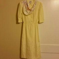 Vintage dress It's a soft yellow vintage springtime dress. Herman Marcus dallas Dresses Midi