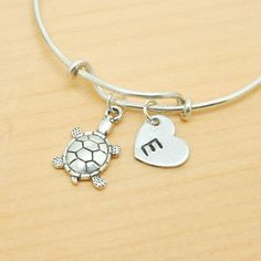 A personal favorite from my Etsy shop https://www.etsy.com/ca/listing/217947208/turtle-bangle-sterling-silver-bangle