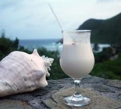 Straight from Biras Creek in the BVI, this tropical drink recipe is their twist on the famous piña colada. Bar Drinks, Cocktail Drinks, Cocktail Glass, Alcoholic Drinks, Beverages, Cocktails Made With Rum, Frozen Cocktails, Painkiller Recipe, Rum Beer