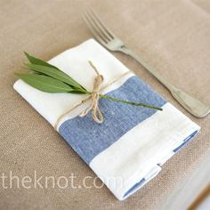 Napkins tied with twine and leaf