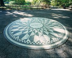 Imagine Circle, Strawberry Fields, Central Park, New York City. People decorate this circle with flowers most days I want to do that once.