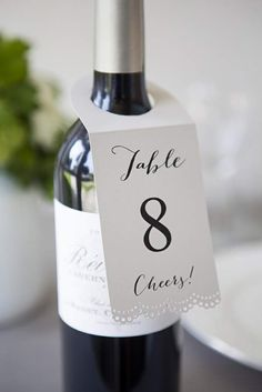 While you can order personalized wine bottle labels with your table numbers, we think this option is much simpler!  Simply hang these labels from the bottle and greet each table with some vino!
