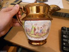 BEAUTIFUL COPPER COLORED 2 SIDED CAMEO WATER PITCHER-6 1/2 inch