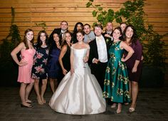 A beautiful happy bride and her guests take a moment to pose in our beautiful hidden courtyard. The custom designed walls make for a amazing photo op backdrops.