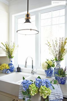 Elegant Spring decorating using pretty blue and vibrant yellow accents along with real and faux florals to help bring a sophisticated yet relaxed feel to your home. #spring #springdecorating #springkitchen