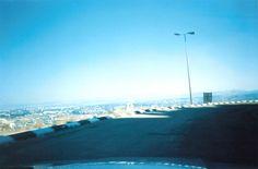 Haifa Bay as seen from high on the mountain, on a hazy day.  photo; mirjam Bruck-Cohen