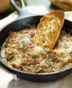 Creamy Warm French Onion Dip made with caramelized onions, beef consomme, cream cheese and Swiss cheese!!