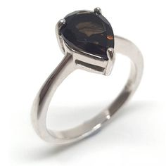 Reconnect yourself to the earth and its life-giving soil with this brown smoky quartz solitaire gemstone ring set in rhodium plated 925 silver. Toe Length, 925 Silver, Sterling Silver, Smokey Quartz, Solitaire Ring, Semi Precious Gemstones, Pear Shaped, Jewelry Branding, Brown And Grey
