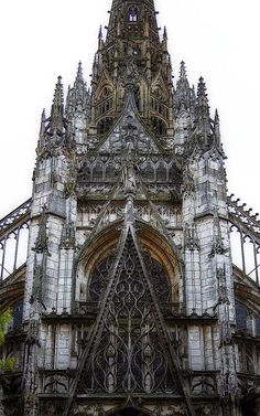 https://flic.kr/p/aJbRkv | Flamboyant | A close up of a fragment of the west front of St Maclou Church in Rouen. The rose window is behind the tall middle gable and it is surmounted by a gable of its own. Above it some parapets, arcading, some pinnacles and a tower. With poster edges filter and Orton effect.