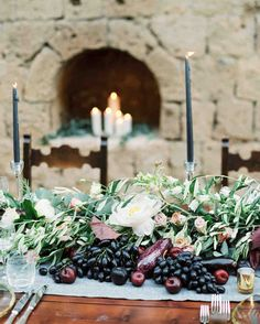 This Romantic Italian Wedding Features a Historic Venue—and One Amazing View | Martha Stewart Weddings - In addition to the flora, a bounty of dark, summer fruit, eggplants, and fresh herbs gathered from that morning's farmer market adorned the tables. And plenty of candlelight too—in the form of gray tapers in gold candlesticks and gold mercury glass votives.
