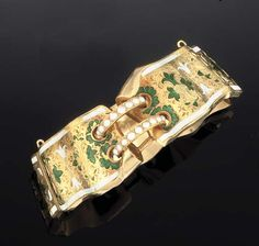 A LATE 19TH CENTURY GOLD AND ENAMEL BANGLE  Designed as a cuff, composed of six hinged, engraved and enamelled shaped panels, the centre linked by two half-pearl semi-circular loops, circa 1890