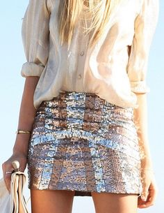 gold armband with sequined skirt & white blouse