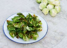 Skinny Girls Brussels Sprouts Chips. I love brussels sprouts.  Seriously.  I've been talking about the goodness of roasted brussels sprouts since I learned about them from Ina Garten 10 yrs ago.  Watching her roast vegetables with olive oil & salt changed my world.  I've never met a roasted vegetable I didn't like. These are simple, delicious & a healthy treat sure to please!