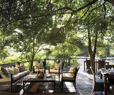 This beautifully situated deck, with a view of the Sabie River and local wildlife, is all yours at the Lion Sands River Lodge.
