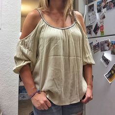 Francesca's Cream and Navy Blue Open Shoulder Top Beautiful Cream Open Shoulder Top. The straps and front of top has navy blue stitching.  Size small. Made with 100% Rayon. Have only been worn once. No wear and tear. Buttons Tops Blouses