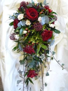 christmas weddings flowers | Shower Bouquet in Reds and Creams with Winter Foliages