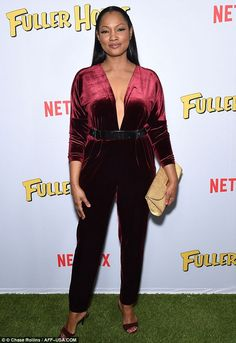 Taking the plunge: Garcelle Beauvais wowed in a red velour jumpsuit
