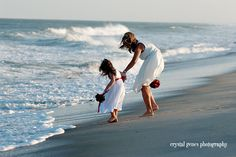Before the vow renewal wedding on the beach at Fort Fisher NC... keeping the flower girl dry!  By Crystal Genes Photography http://www.crystalgenes.net