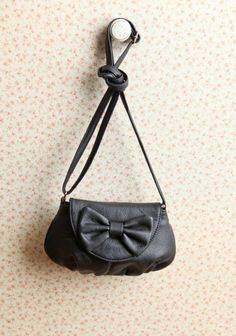 bow crossbody bag... I have a similar one in maroon... Love tiny cute bags!