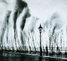 Waves striking seawall give appearance of geysers erupting. New England coast – 1938. Photo #29 by NOAA / National Weather Service