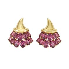 Pair of Gold and Pink Tourmaline Earclips by Verdura. 18 kt., the stylized cornucopias embellished by two rows of 22 oval pink tourmalines, approximately 16.2 dwts.