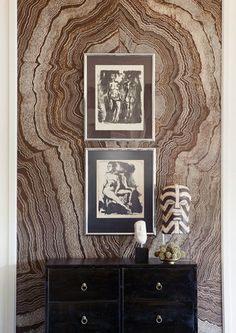 Gabriel Hendifar onyx wall, framed black white drawings, black cabinet, brass hardware