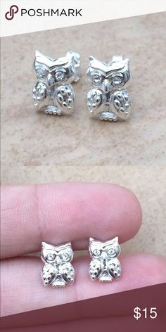 Sterling Silver 925 Crystal Owl Bird Stud Earrings Sterling silver stud earrings feature adorable owls with crystals set in the eyes.  Posts with friction backs.  Measures 3/8 inch L x 1/4 inch W. Jewelry Earrings