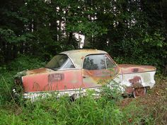 Nash Metropolitan by Caleb+OldStuff, via Flickr - When I was a kid we had one of these (two-tone blue). Almost everything fell off or out on a 2-week road trip vacation. My dad left it on the side of the road.