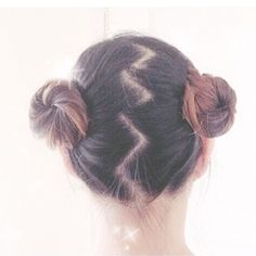 Clean pigtail buns with zig zag hair part.