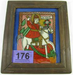"Lot 176 in the 1.7.14 online & live auction! Stunning vintage framed Romanian Orthodox Religious Icon reverse glass painting. Hand painted rendition of St. George and the Dragon. Handwritten note reads ""Romanian icon, recent production, tempera on glass, St. George and the Dragon. Based on the Cyrillic inscription, the template for the icon dates from the 1st half of the 19th century. Bought in a consignment shop in Bucharest in 1982."" #Religion #Art #Décor #Home #Church #POGAuctions"