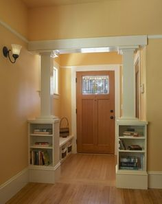 "Craftsman columns on either side of room. ""Dividing"" living and kitchen."