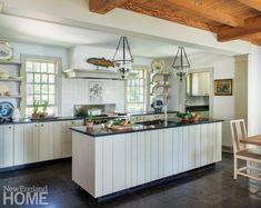 An antique fish weathervane decorates the kitchen's custom hood.
