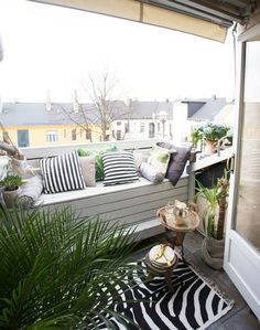 Maximize even the smallest balcony with a cushioned bench | via BLOCK PRINT SOCIAL