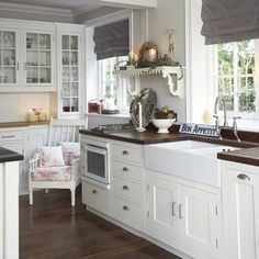 nice kitchen ideas...the sink is great, darker countertops with darker floor, and the glass fronted cupboards very visually appealing