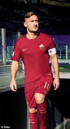 Francesco Totti shows off Roma's new kit which they will wear against Lazio on Sunday