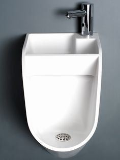 Kaspars Jursons is trying to help solve European water shortages by redesigning the men's restroom. His new urinal design, called Stand, includes a tap and sink right over it. Man Cave Basement, Man Cave Garage, Garage Bar, Garage Sink, Garage Walls, Garage Ideas, Wc Public, Man Cave Bathroom, Toilet Sink