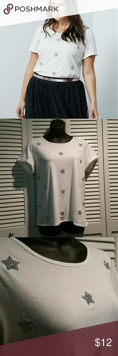 Torrid star applique tee, size 1 White (maybe a little bit of an off white) torrid dressy tee with beaded appliques on the front. It has only ever been handwashed, never dried. No appliques coming loose. Very sparkly, great for special occasion or just under a jacket torrid Tops Tees - Short Sleeve