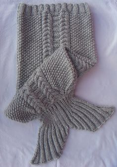 Knitting instructions to make a Mermaid Tail Blanket.