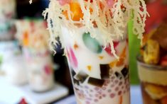 """Halo-halo, Philippines A cup of multicoloured halo-halo is the perfect way to cool down on a hot and sticky Philippine summer day. Directly translated as """"mix-mix"""", it's an attractive sundae like concoction of red beans, coconut, syrup and fruit, usually topped with ice cream, evaporated milk and shaved ice."""