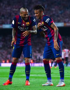 Neymar of FC Barcelona celebrates with his teammate Dani Alves after scoring his team's second goal during the Copa del Rey Final match between FC Barcelona and Athletic Club at Camp Nou on May 30, 2015 in Barcelona, Spain.