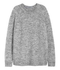 Gray melange. Sweater in a soft knit with wool and mohair content. Wide ribbing at neckline, long raglan sleeves, and ribbing at cuffs and hem.