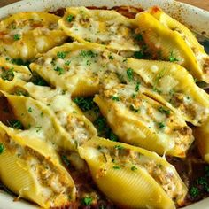 Lasagna Stuffed Shells ____ this reciepe is for a meat lasagna _____ make a vegetarian Lasagna Stuffed Shells -- make sure to use spinach, artichoke, and garlic ___ YUM !!!!!