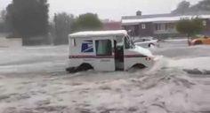 A Postal Worker Fighting Raging Flood Waters In Colorado Springs