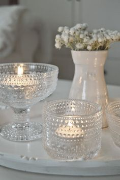 Candle scape with crystal and white. Candels, Candle Lanterns, Votive Candles, Candlesticks, Candlestick Holders, Marimekko, Flower Decorations, Christmas Decorations, Home Decor Accessories