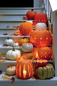 Halloween decor pumpkins Carve a Pattern - Fabulous Fall Decorating Ideas - Southernliving. Turn standard grocery store pumpkins into decorative votive holders that are embellished with polka-dot cutouts. How To Make It: Decorative Pumpkin Votive Holders Theme Halloween, Holidays Halloween, Halloween Pumpkins, Halloween Crafts, Happy Halloween, Halloween 2017, Chique Halloween, Halloween Buffet, Trendy Halloween