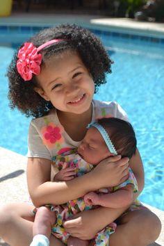 Beautiful biracial babies! Love her curls!