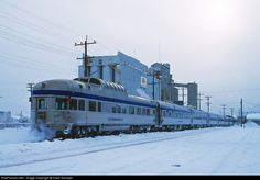 Here the westbound train departs Thunder Bay with the park series dome observation car Tweedsmuir Park bringing up the rear. December 1988