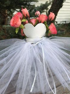 Perfect centerpiece for your Bridal Shower. Created with a large mason jar with a white and silver tulle skirt and sparkly heart bodice. Trimmed with ribbons and pearls. The mason jar will hold your floral arrangement WHICH IS NOT INCLUDED. Please keep in mind that these are handmade items and each will have slight differences.  ****CUSTOMIZATION IS AVAILABE*******use the link below  https://www.etsy.com/listing/521372005/custom-bridal-gown-centerpiece-bridal?ref&#x3D...