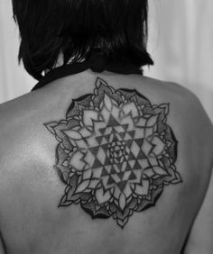 The Sri Chakra (called the Shri Yantra) is the symbol of Hindu tantra, which is based on the Hindu philosophy of Kashmir Shaivism. http://www.puncturedartefact.com/blog/4582926754/SYMBOLIC-INK.-The-yantra/7948183
